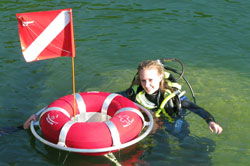 Scuba diver with dive flag in Norfork Lake