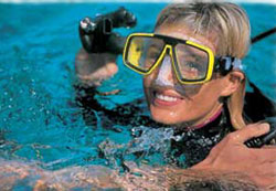 Girl taking scuba diving lesson