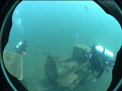 Diver explore underwater wreck Norfork Lake