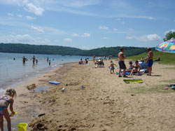 Families on sandy beach at Norfork Lake